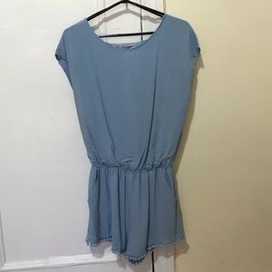Baby blue romper with open back and pompon trim